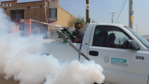 a person fumigating the street